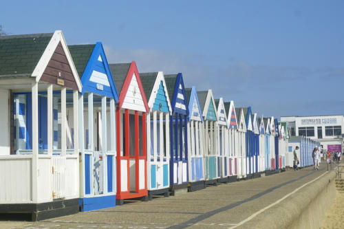 18 Intermediate Beach Huts near Southwold Pier by Bob Winfield