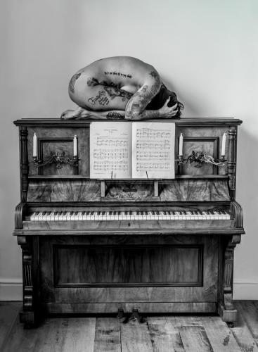 Tattooed Nude on Piano by Dave Shrubb Highly Commended