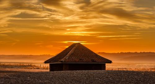 Adv HC. Beach Shelter at Cley Next The Sea by Roger Craven